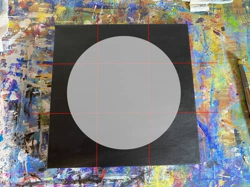 A digital representation of a gray circle on a black canvas with a red grid that divides the canvas into nine boxes.